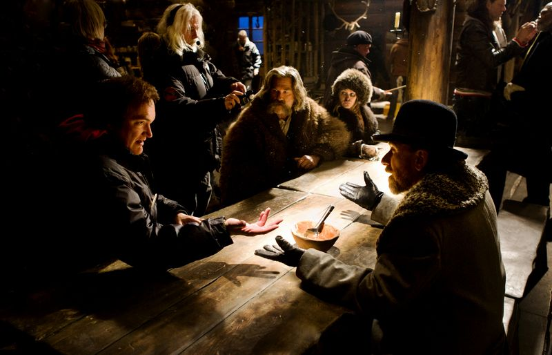 (L-R) QUENTIN TARANTINO directs KURT RUSSELL, JENNIFER JASON LEIGH, and TIM ROTH on the set of THE HATEFUL EIGHT. Photo: Andrew Cooper, SMPSP © 2015 The Weinstein Company. All Rights Reserved.